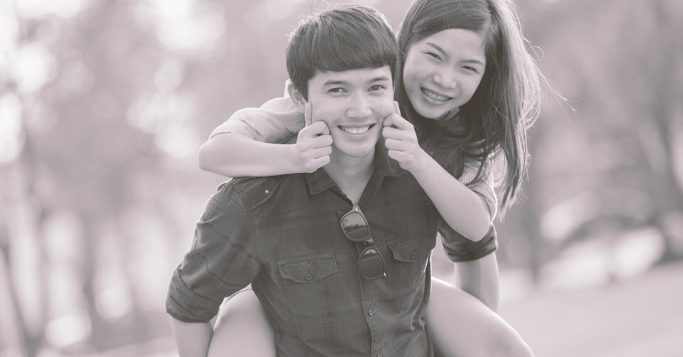 Young couple with youthful chubby cheeks.
