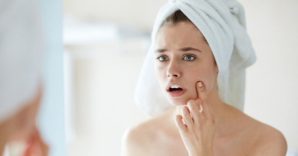 Woman starting to worry about sunken cheeks and sagging cheeks.